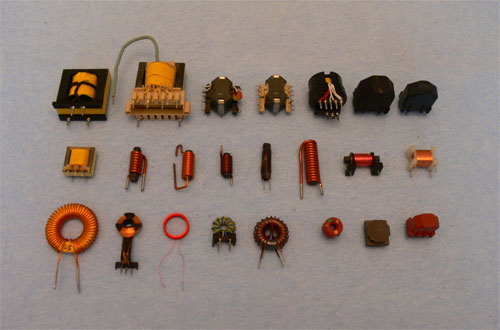 Assortment of transformers and chokes on ferrite core